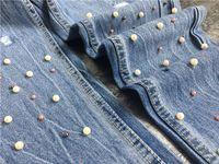 Вышивка бисером на джинсовой ткани